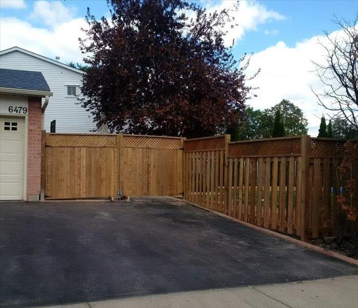 fence rebuilt by driveway