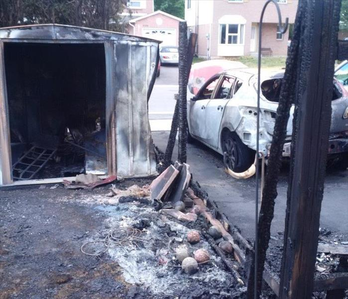garden shed, fence and car burned after a fire