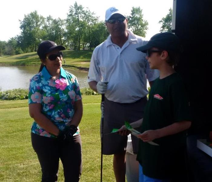 Disscussing SERVPRO at the Oakville Milton & District Real Estate Board Charity Golf Tournament